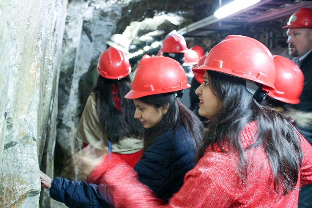 Students examining mine