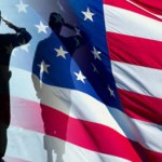 Silhouette saluting flag