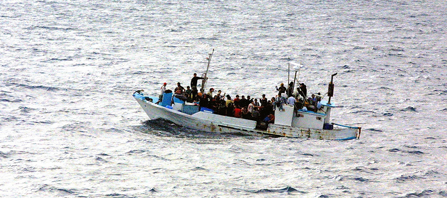refugees on boat at sea