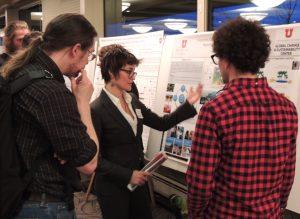 student explaining poster