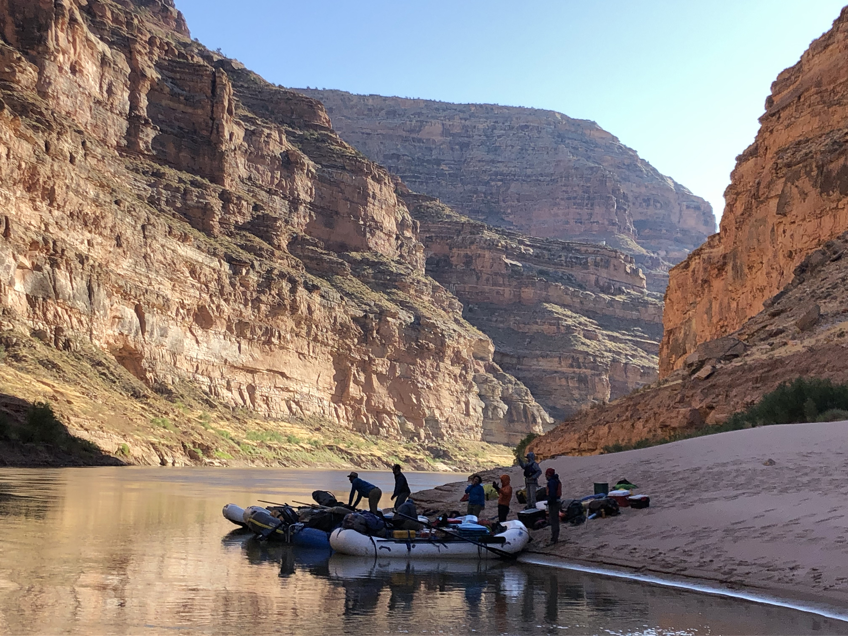 researchers load rafts in preparation to float the canyon river